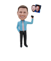 Businessman Bobbleheads In Blue Shirt With Cellphone In Hand
